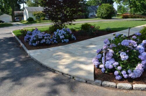 Bolton Landscape Design & Masonry specializing in plantings, sprinkler systems, patios, grills, driveway construction, and grading since 1979.