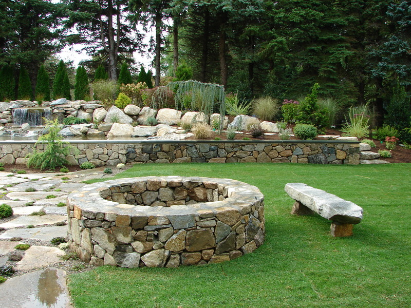 Bolton Landscape Design & Masonry specializing in plantings, sprinkler systems, patios, grills, driveway construction, and grading since 1979. fire pit fireplace