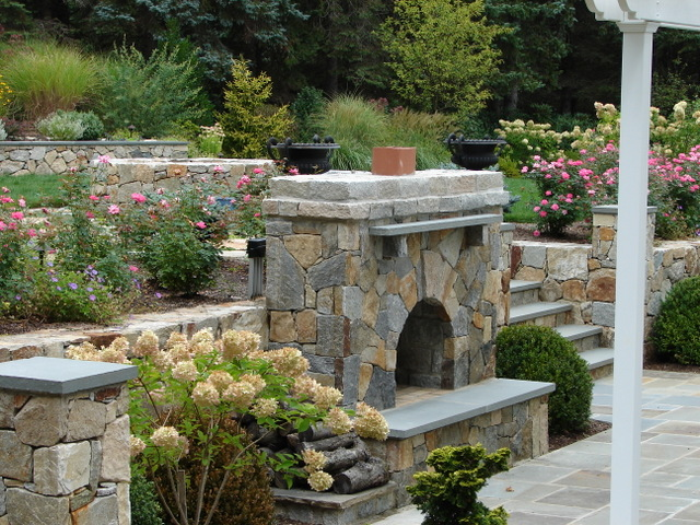 Bolton Landscape Design & Masonry specializing in plantings, sprinkler systems, patios, grills, driveway construction, and grading since 1979. fireplace fire pit
